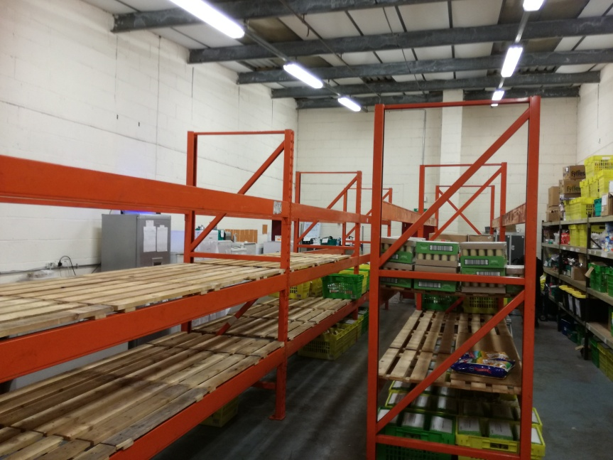 Donated shelving in the TRJFPBrum warehouse