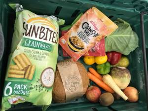 Freegan Box containing vegetables,crisps, cereal and bread