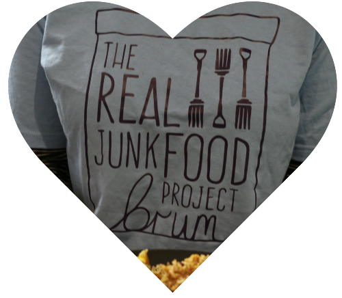 Heart shape enclosing a person wearing a TRJFP Brum t-shirt serving food